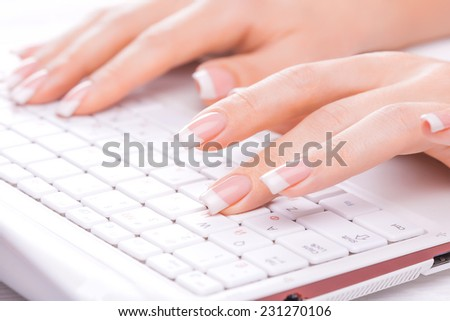 Hands of an office woman typing on the white - stock photo