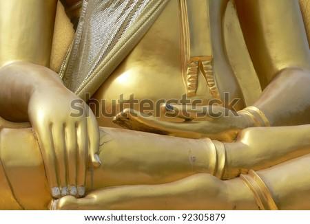 Hands of Buddha statue - lotus position - stock photo