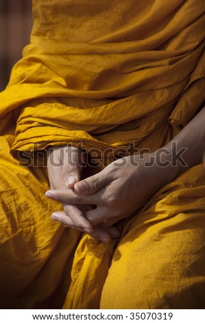 Hands of Buddhist Monk - stock photo