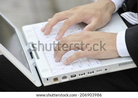 Hands Of Business Man Typing