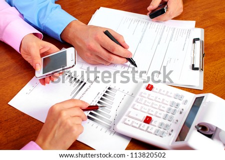 Hands of business people group working in the office. - stock photo