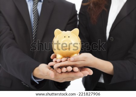 hands of business people holding a piggy bank .financial or saving concept over with background