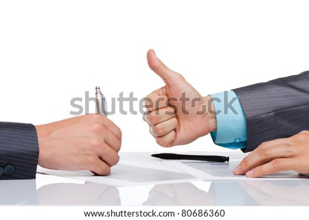 Hands of business people in elegant suits sitting at desk working in team together, with document with thumbs up gesture, Concept Success, Approval, Good Work, sign up Isolated over white background - stock photo