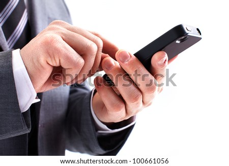 Hands of businessman calling by phone. Isolated on white background. - stock photo