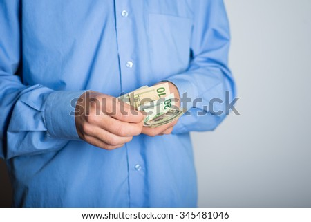 hands of businessman count money dollars. advertising concept, isolated on a gray background. - stock photo