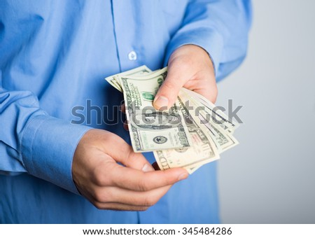 hands of businessman count money dollars. advertising concept, isolated on a gray background.