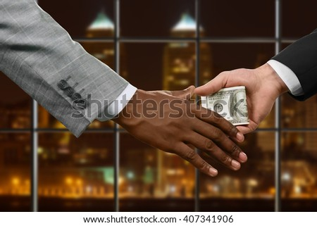 Hands of businessmen passing money. Hands pass cash at night. Every chain has a weakness. Corruption at its best. - stock photo