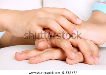 Hands of children, concepts of solidarity and teamwork
