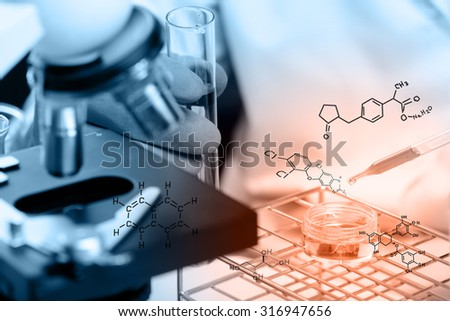 Hands of clinician holding tools during scientific experiment ,Hands of clinician holding tools during scientific experiment ,Researcher is dropping the reagent into test tube, with chemical equations - stock photo