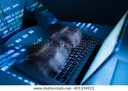 Hands of coder typing very fast, blurred motion - stock photo