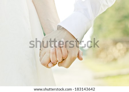 hands of couple in Wedding day love - stock photo
