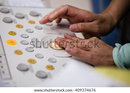 Hands of doctor working at the ultrasound device,Echocardiography - stock photo