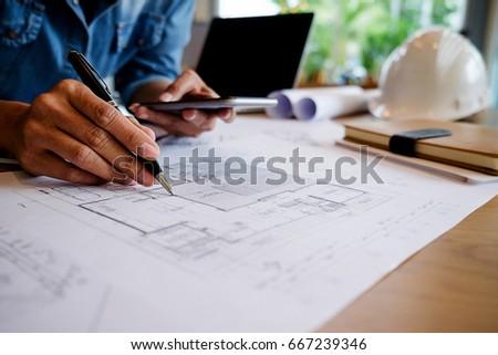Hands engineer working on blueprint construction stock photo hands of engineer working on blueprint construction concept engineering toolsntage tone retro malvernweather Image collections