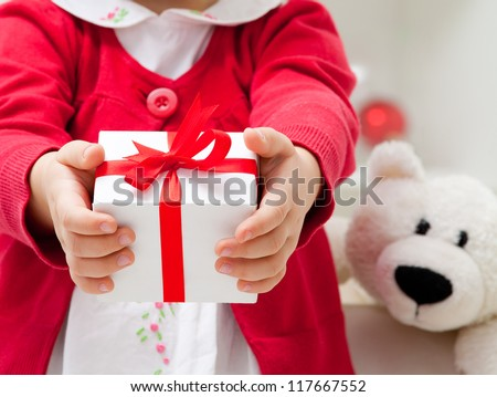 Hands of  little girl with Christmas present. unrecognizable - stock photo