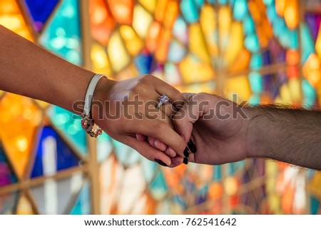 hands of lovers on a very beautiful and bright background