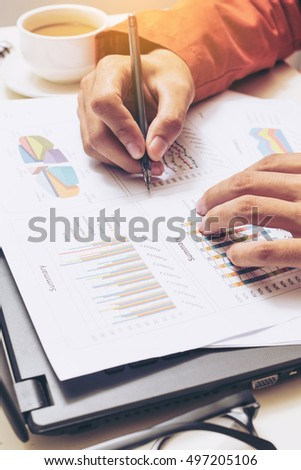 Hands of male business  signing paper