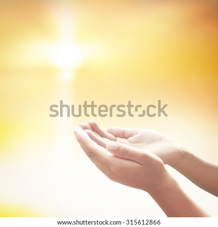 Hands of man praying over blurred the cross on a sunset background. Christmas background, Worship, Forgiveness, Mercy, Humble, Repentance, Reconcile, Adoration, Glorify, Peace concept. - stock photo