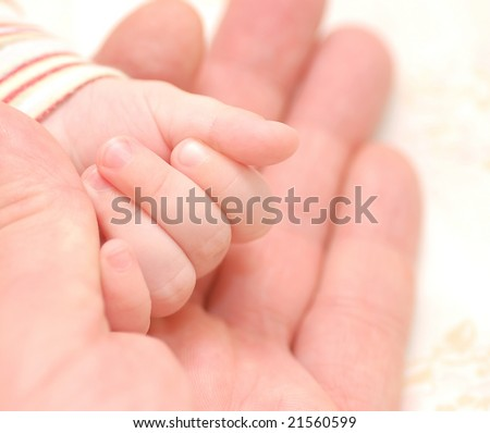 Hands of men and baby