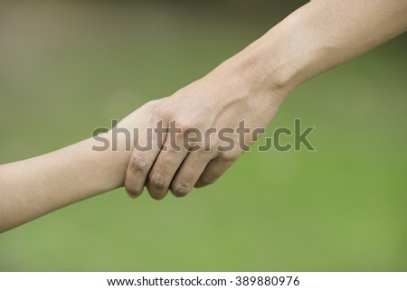 Hands of mother and son