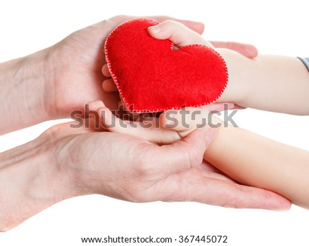 Hands of mother and son holding heart symbol - stock photo