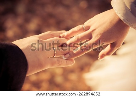 hands of newlyweds with rings
