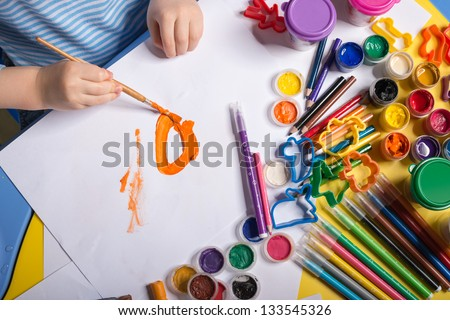 Hands of painting little boy - stock photo