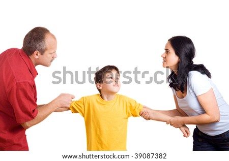 Hands of parents fighting over their son each pulling him their way.