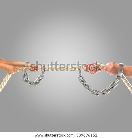 Hands of people pulling the rope. Competition concept