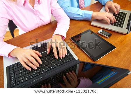 Hands of people working in the office. Technology. - stock photo