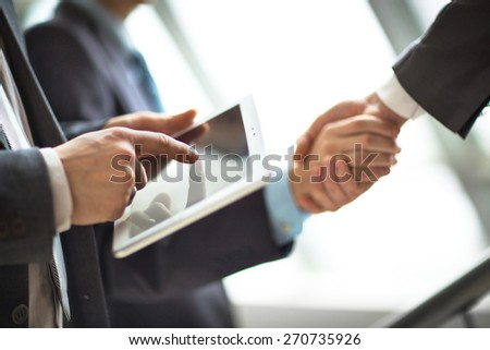 Hands of people working with tablet computer. - stock photo