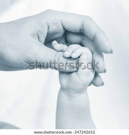 hands of the baby and mom - stock photo