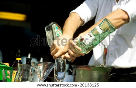 Hands of the barman mixing an alcoholic cocktail - stock photo