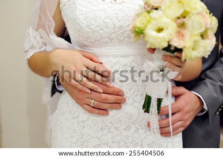 hands of the bride and groom with wedding rings. - stock photo