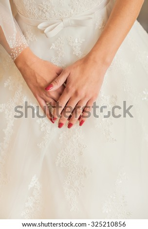 Hands of the bride with wedding ring - stock photo