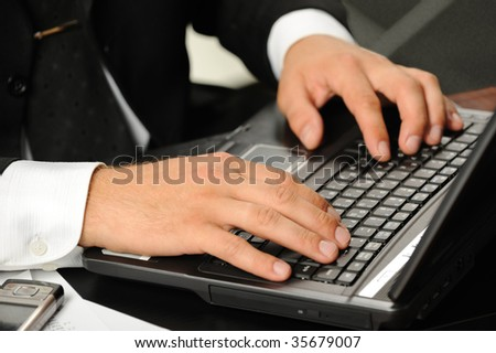 Hands of the businessman above the keyboard laptop - stock photo
