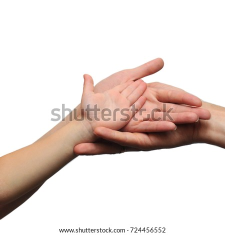 hands of the father of mother and baby on a white background