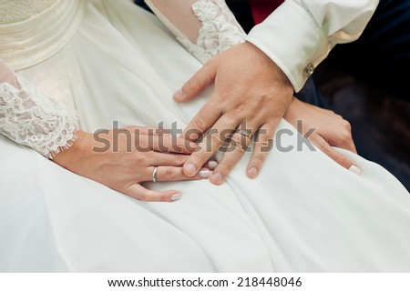 Hands of the groom and the bride - stock photo