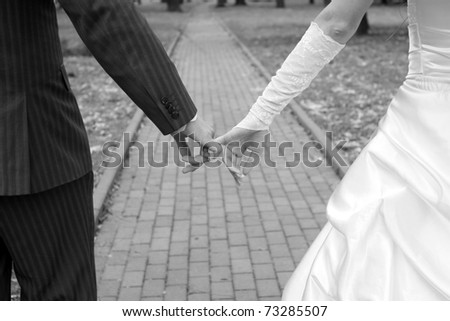 Hands of the groom and the bride with rings - stock photo