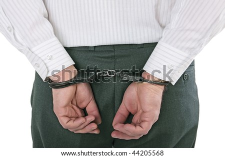 Hands of the man behind the back in handcuffs, isolated on the white background - stock photo