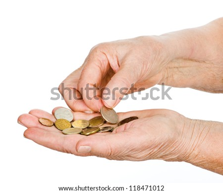 hands of the old man touching last coins. isolated on white background - stock photo