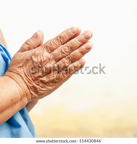 Hands of the old woman , focus on hands - stock photo