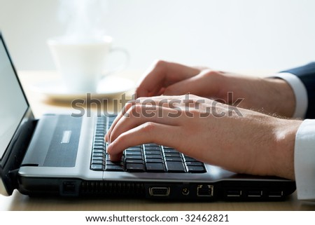 Hands of the typing businessman