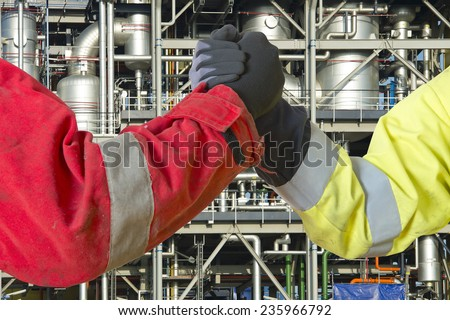Hands of two engineers joining in closing a deal for the oil, gas and energy market as contractors, conceeding in a grant to cooperate on a joint venture. - stock photo