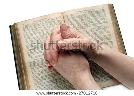 Hands of woman closed on open Bible, isolated
