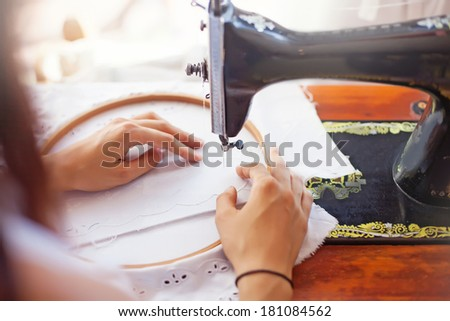 Hands of woman sewing - stock photo