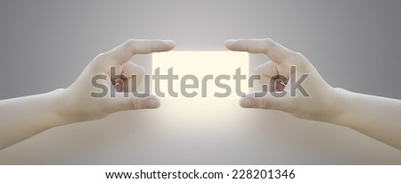 Hands of women holding blank paper label or tag - stock photo