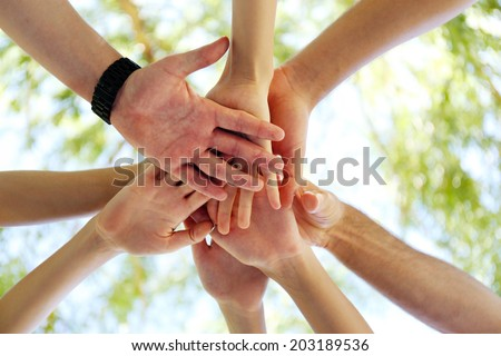 Hands of young people close up - stock photo