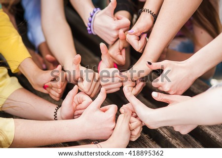 Hands of young people in the nature, team concept