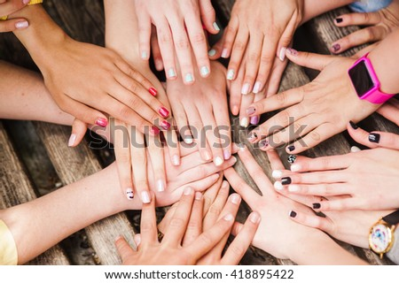 Hands of young people in the nature, team concept - stock photo