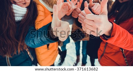 Hands of young people in the winter, team concept